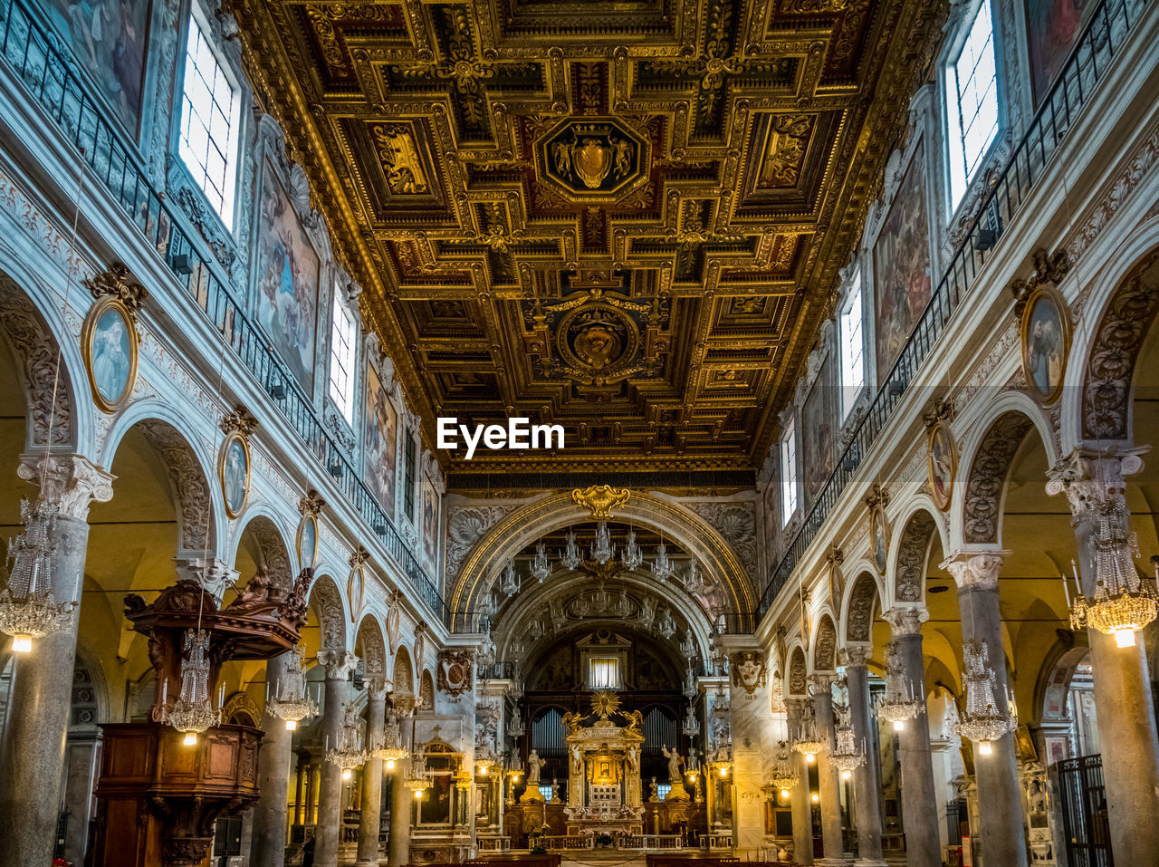 architecture, built structure, travel destinations, building exterior, place of worship, the past, belief, illuminated, history, low angle view, religion, spirituality, lighting equipment, ceiling, building, arch, travel, architectural column, no people, ornate, luxury, mural