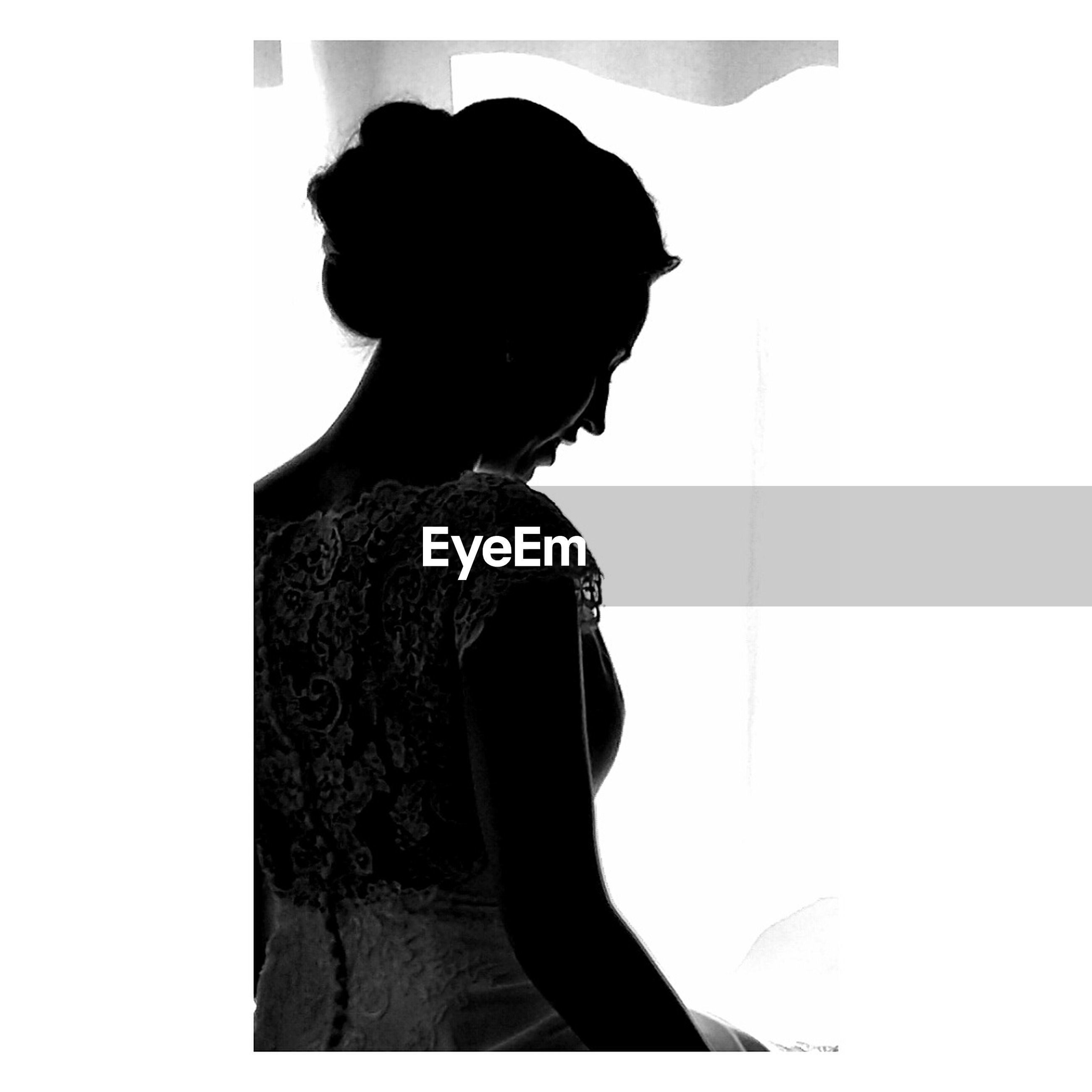 silhouette, only women, one woman only, one person, rear view, loneliness, depression - sadness, adults only, women, real people, adult, standing, people, white background, indoors, day, young adult