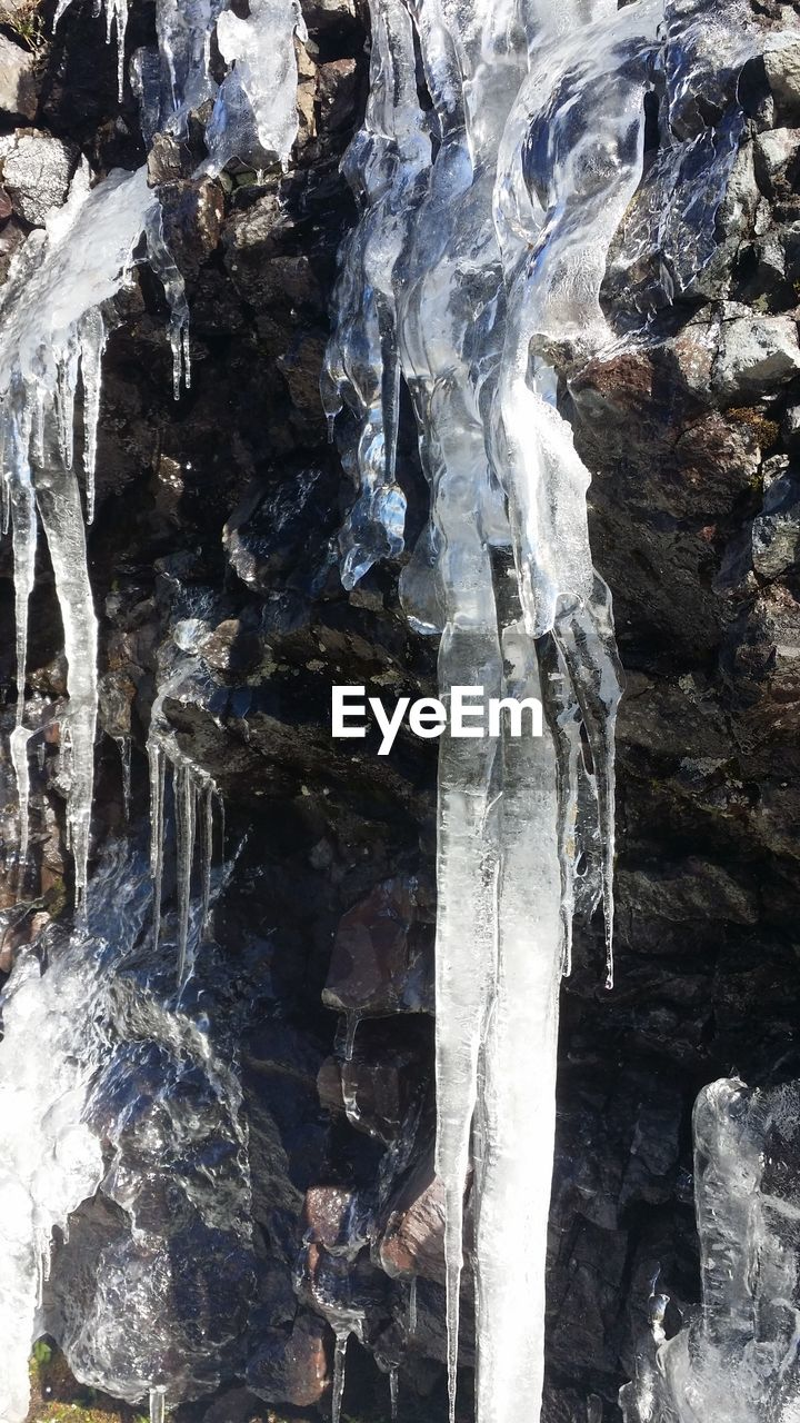 rock - object, rock formation, ice, nature, waterfall, textured, frozen, beauty in nature, full frame, no people, cold temperature, physical geography, outdoors, scenics, day, water