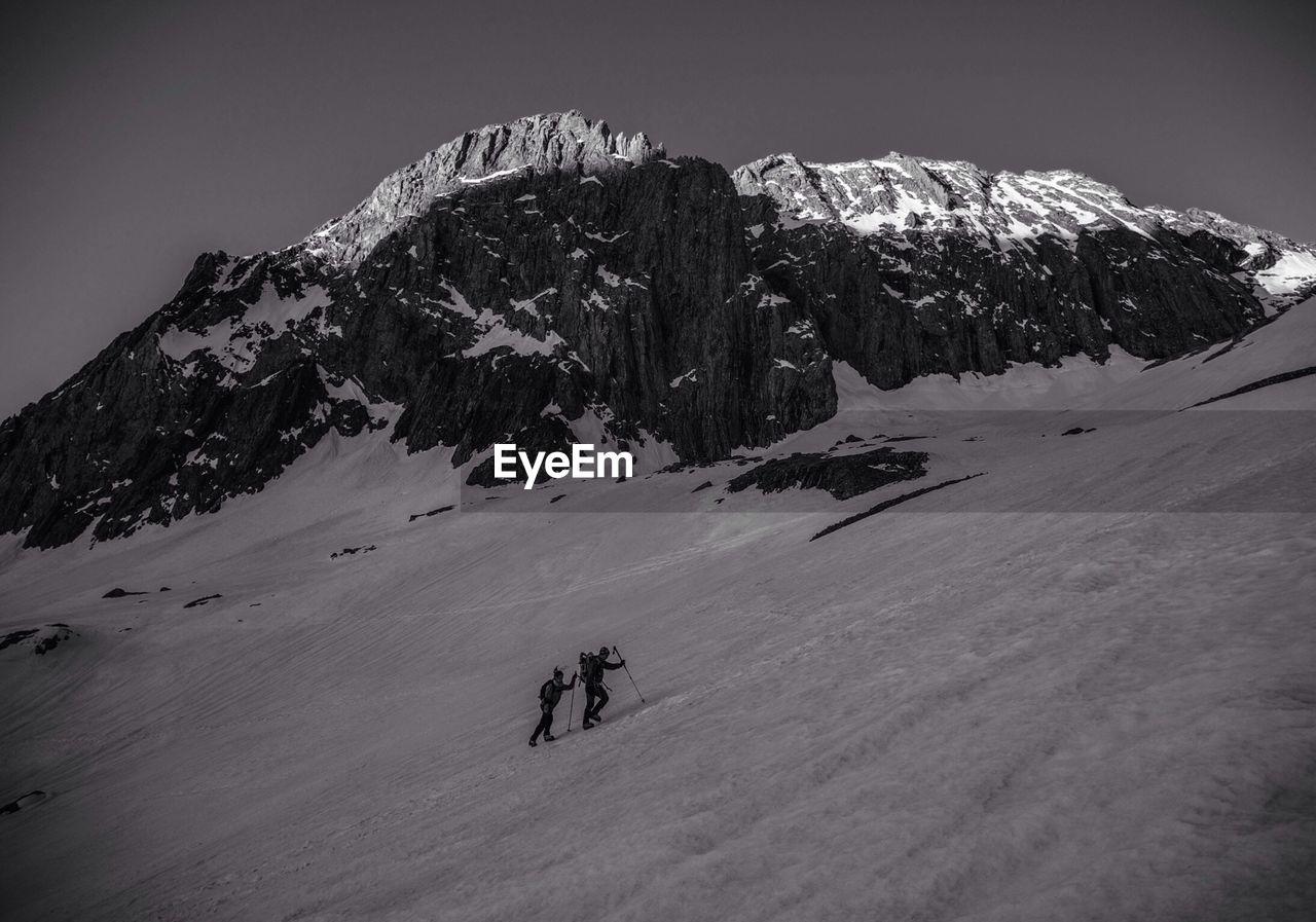 Men Hiking In Mountains