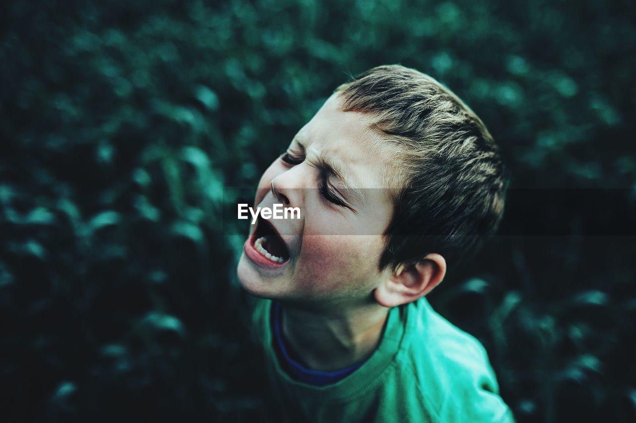 SIDE VIEW PORTRAIT OF BOY