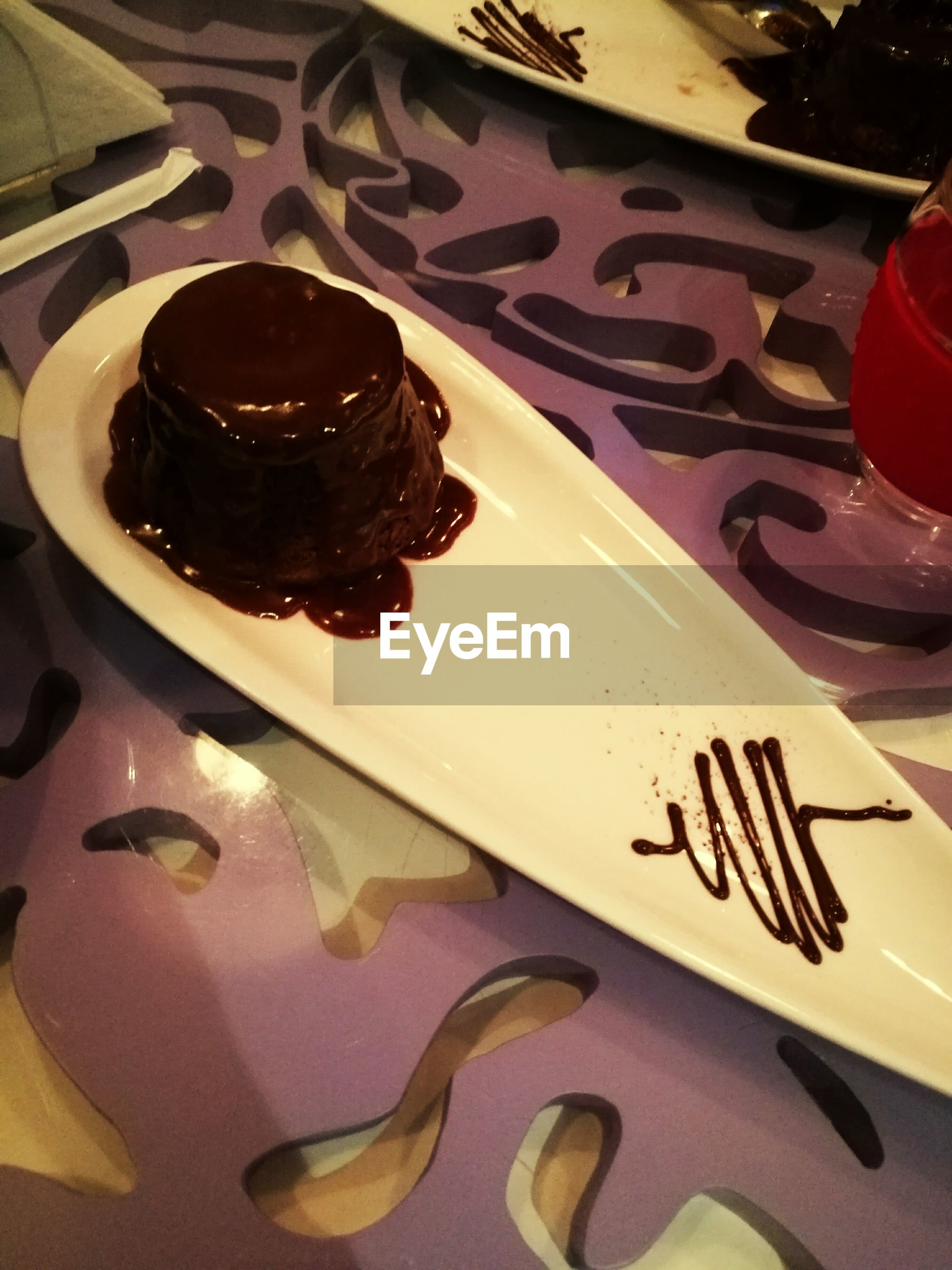 indoors, chocolate, sweet food, dessert, plate, food and drink, food, indulgence, high angle view, temptation, close-up, unhealthy eating, no people, brownie, ready-to-eat, day
