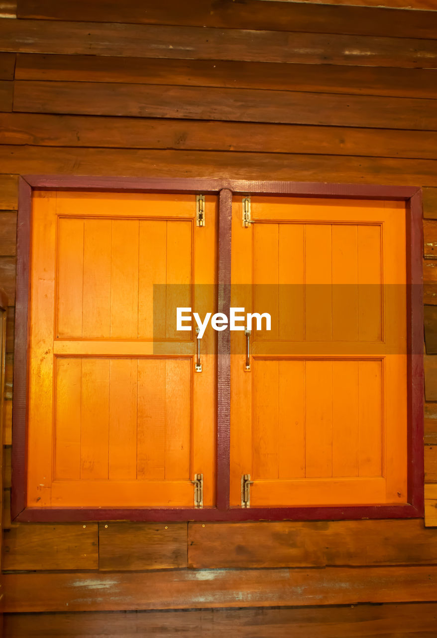door, wood - material, entrance, architecture, wood, closed, indoors, no people, built structure, building, brown, residential district, security, safety, protection, house, yellow, garage