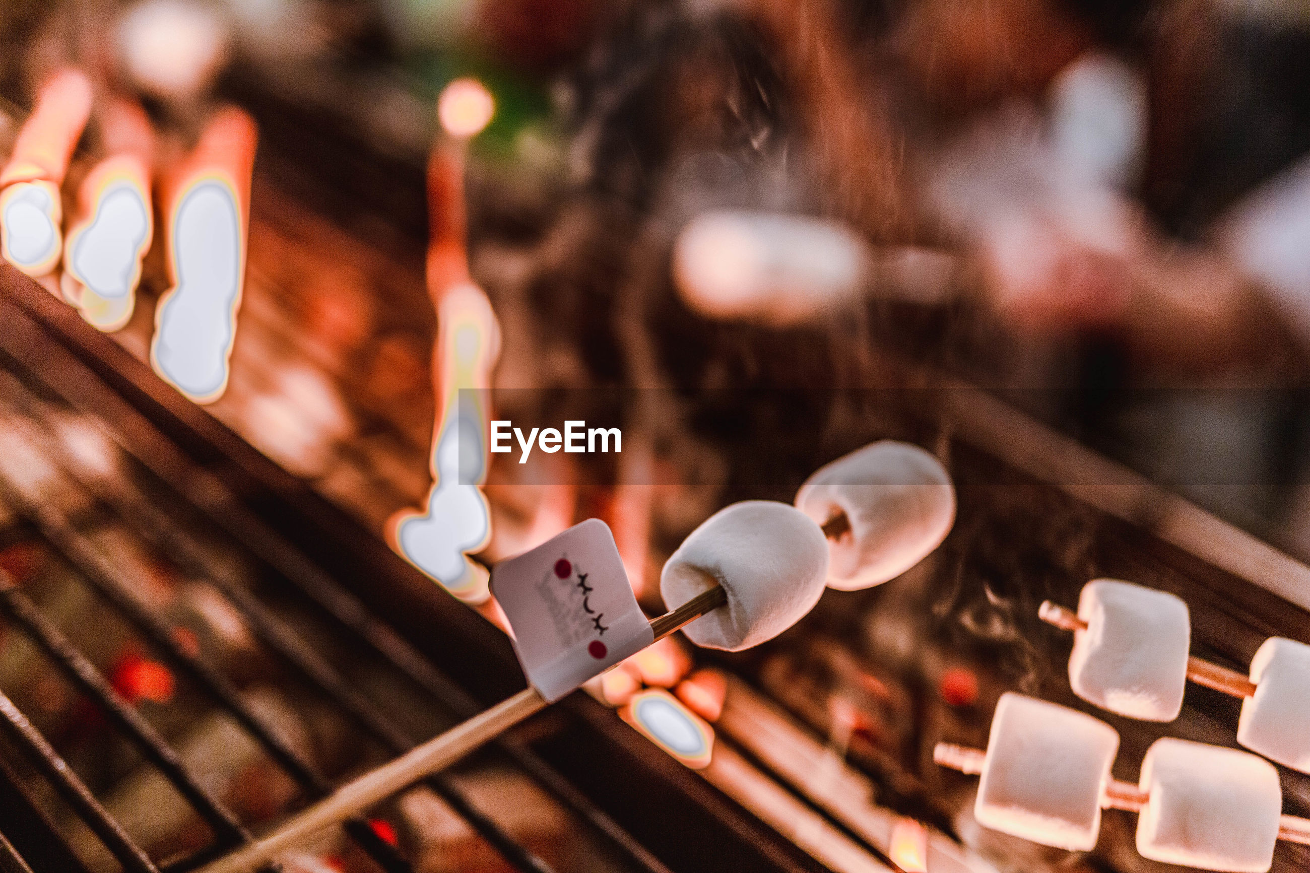 Close-up of marshmallows roasting on barbecue