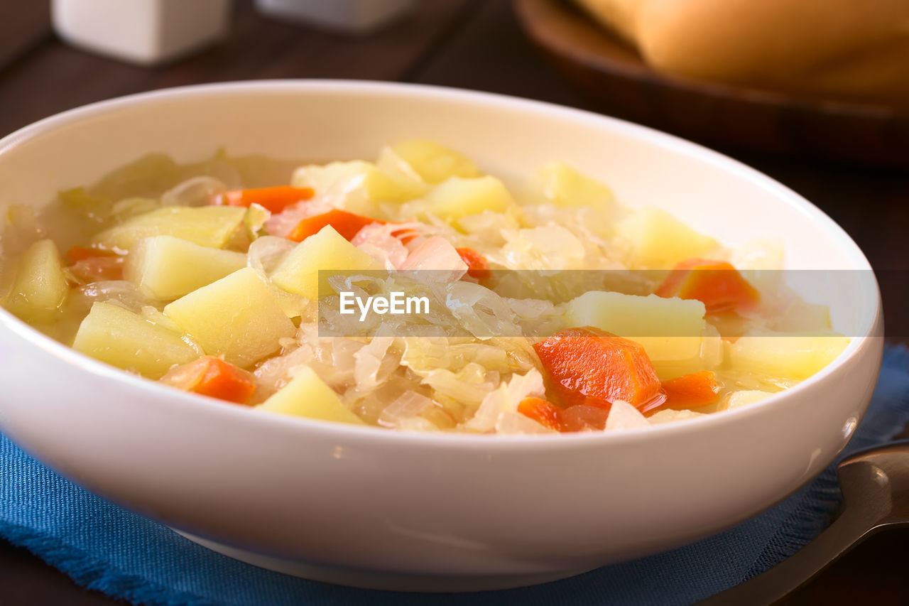 food, food and drink, healthy eating, bowl, wellbeing, ready-to-eat, freshness, vegetable, no people, indoors, close-up, table, serving size, still life, meal, selective focus, high angle view, fruit, salad, slice, vegetarian food, soup bowl, temptation, crockery