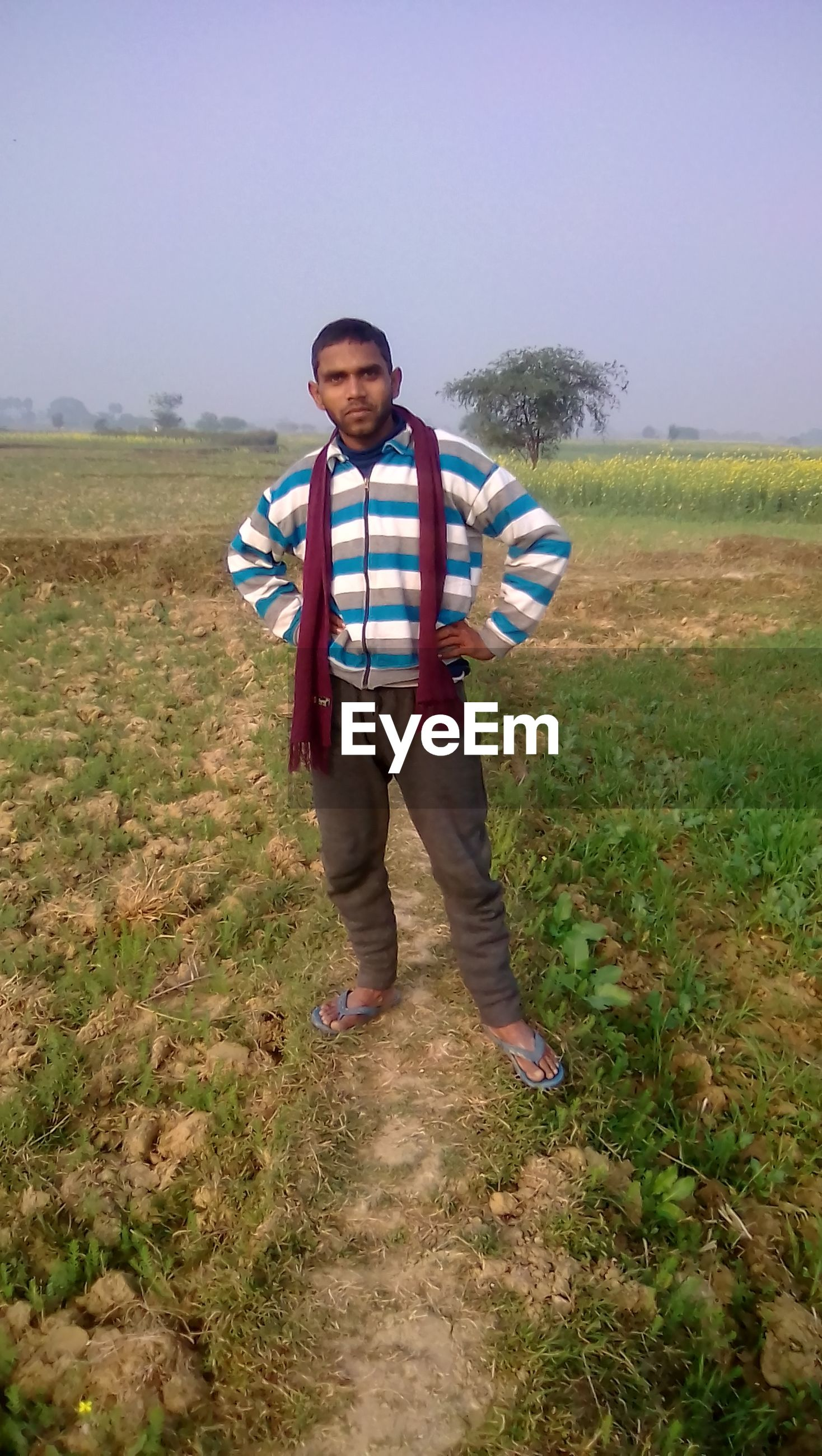 Full length of portrait of man standing in farm