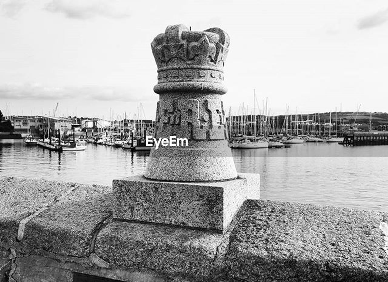 harbor, water, sea, sky, outdoors, built structure, moored, beach, day, travel destinations, nautical vessel, no people, architecture, nature, building exterior, groyne