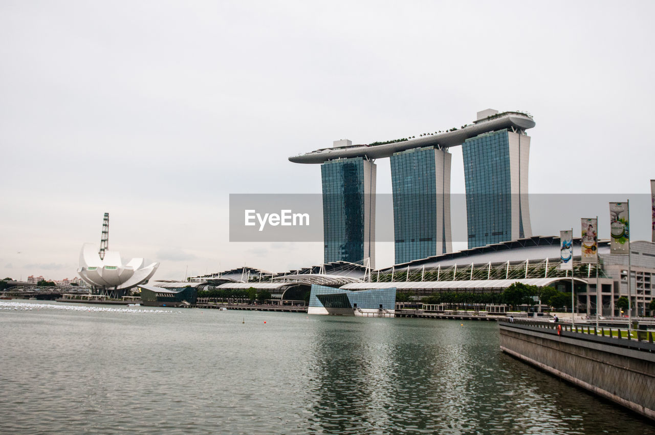 Marina Bay Sands And Artscience Museum By Sea Against Sky In City