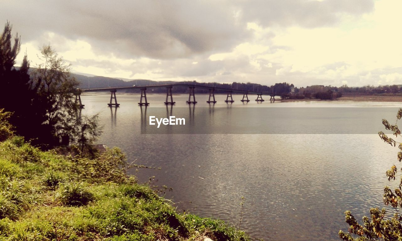 water, river, connection, sky, bridge - man made structure, nature, cloud - sky, no people, outdoors, day, built structure, architecture, beauty in nature, tree