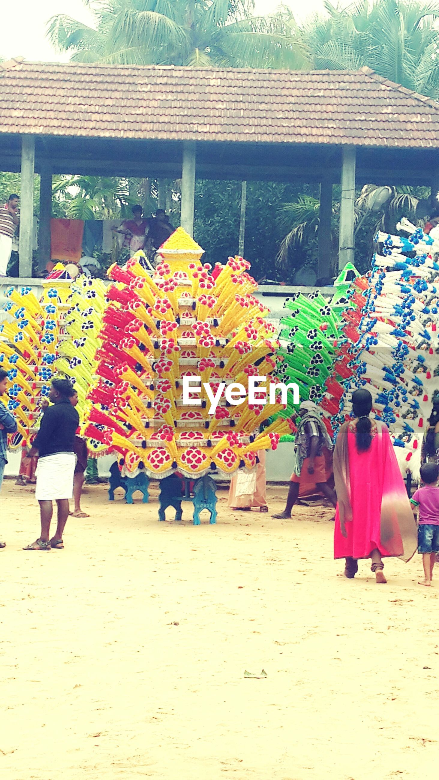 person, multi colored, lifestyles, abundance, market stall, leisure activity, retail, men, variation, large group of objects, for sale, in a row, tradition, market, large group of people, built structure, cultures, day, flower