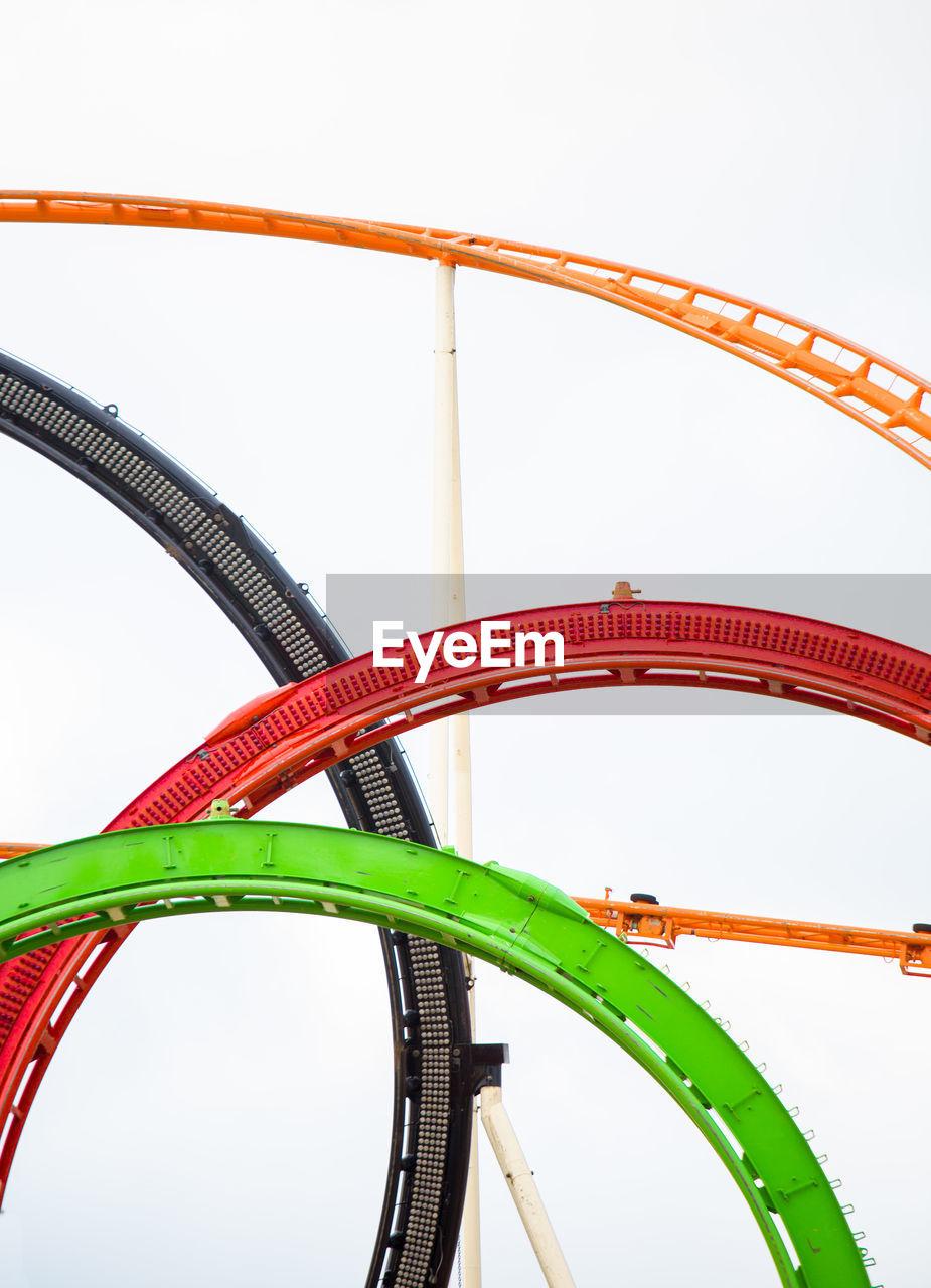 amusement park ride, rollercoaster, amusement park, no people, curve, architecture, connection, nature, built structure, sky, arts culture and entertainment, metal, adventure, leisure activity, sport, day, close-up, low angle view, white background, carnival, excitement, wheel