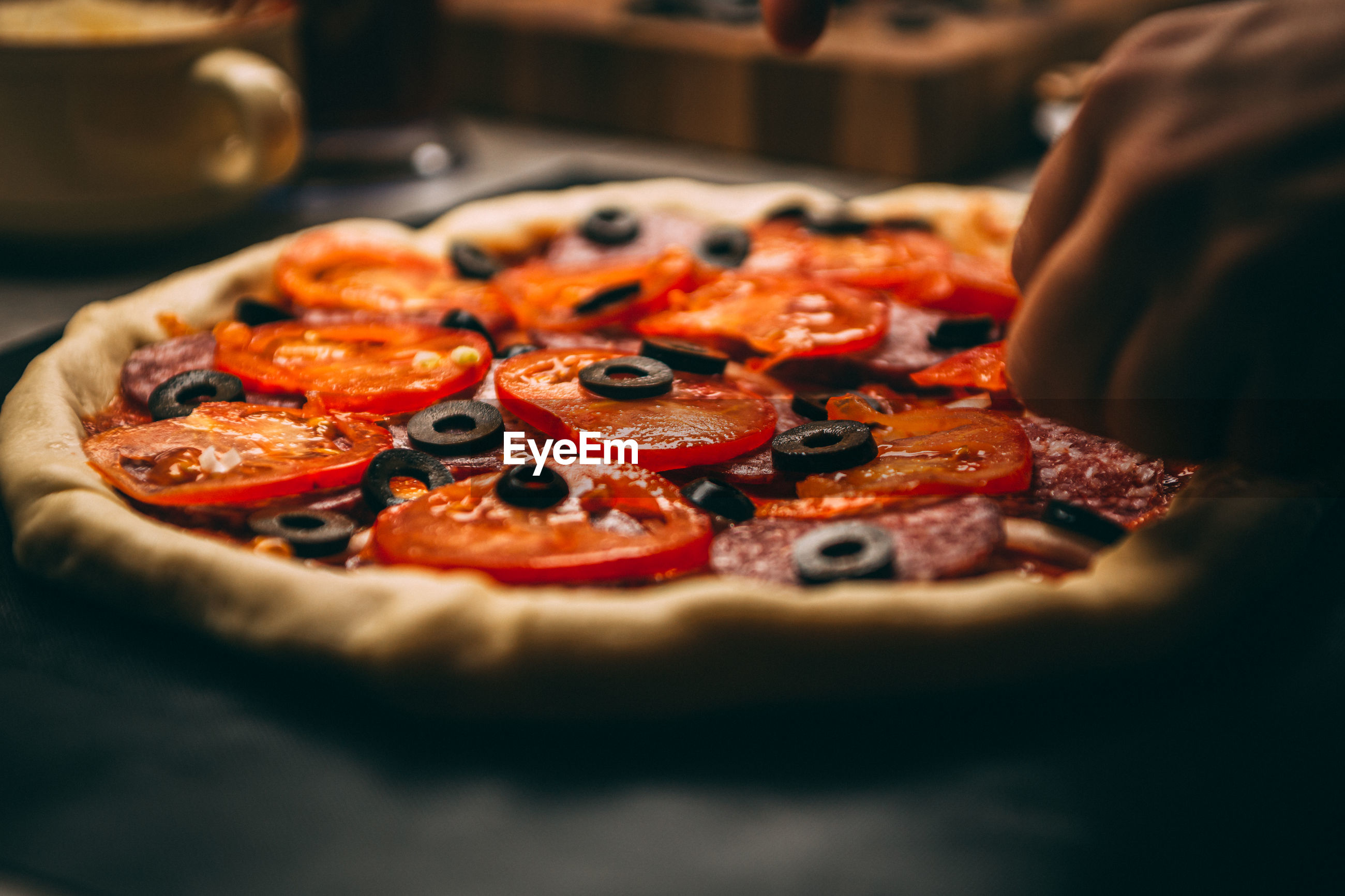 CLOSE-UP OF PIZZA ON ICE