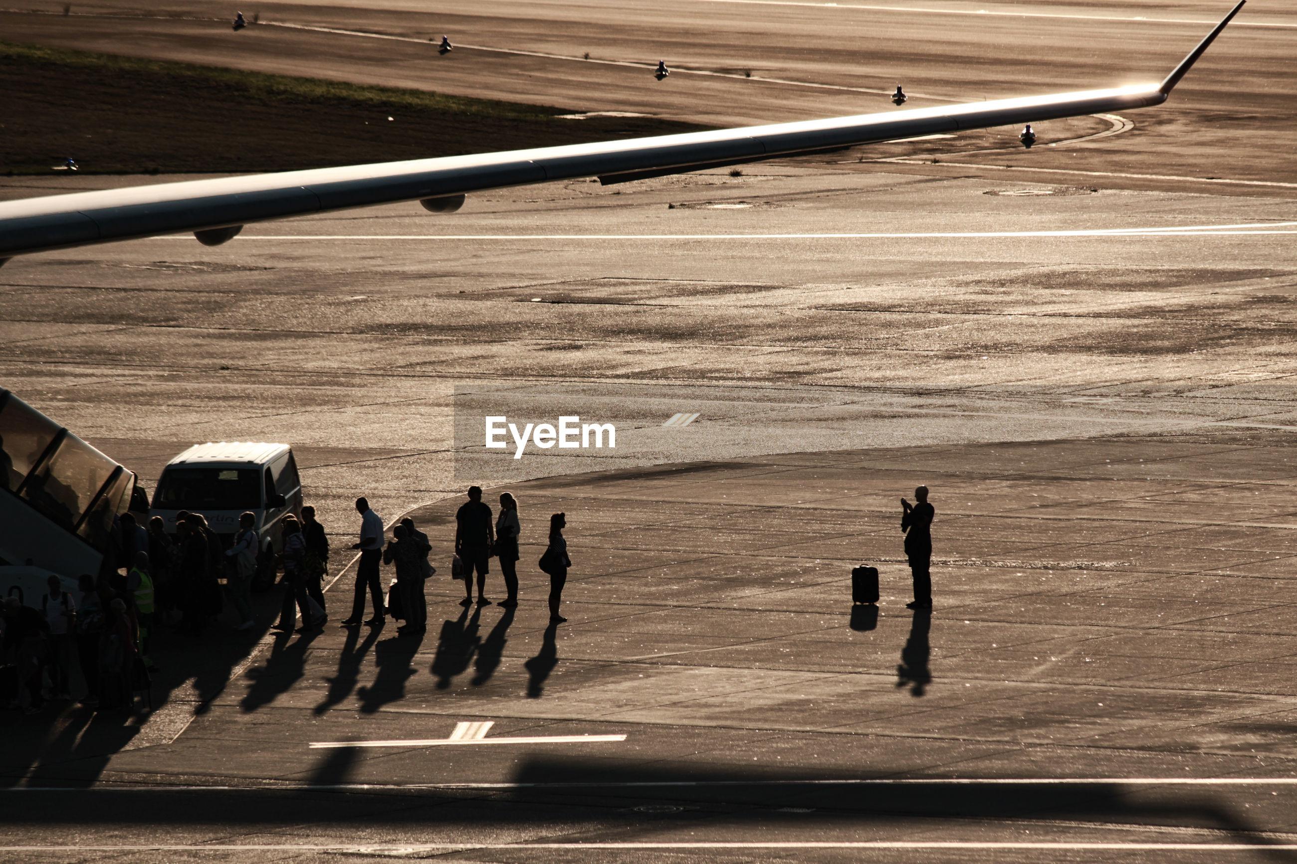 People at airport runway