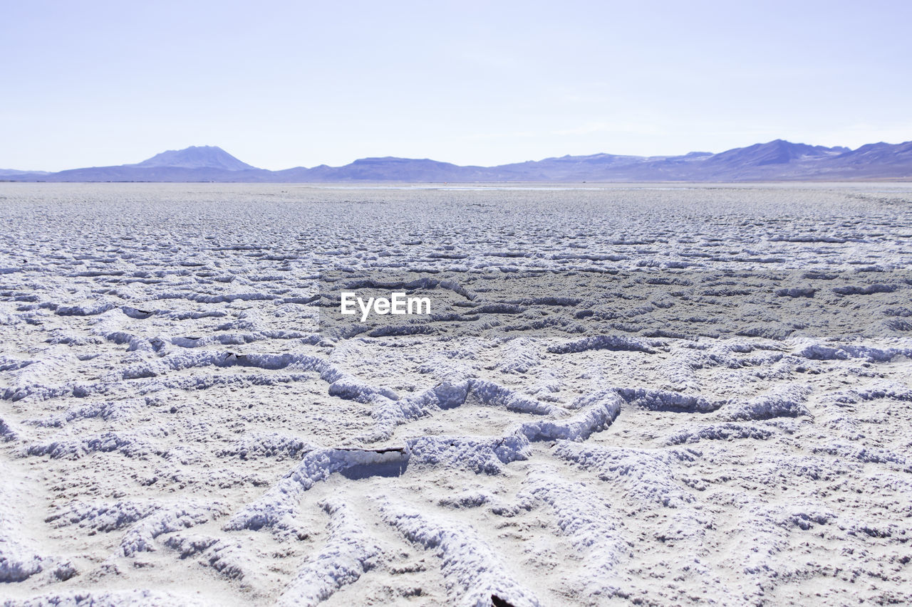 Scenic view of salt flat against sky