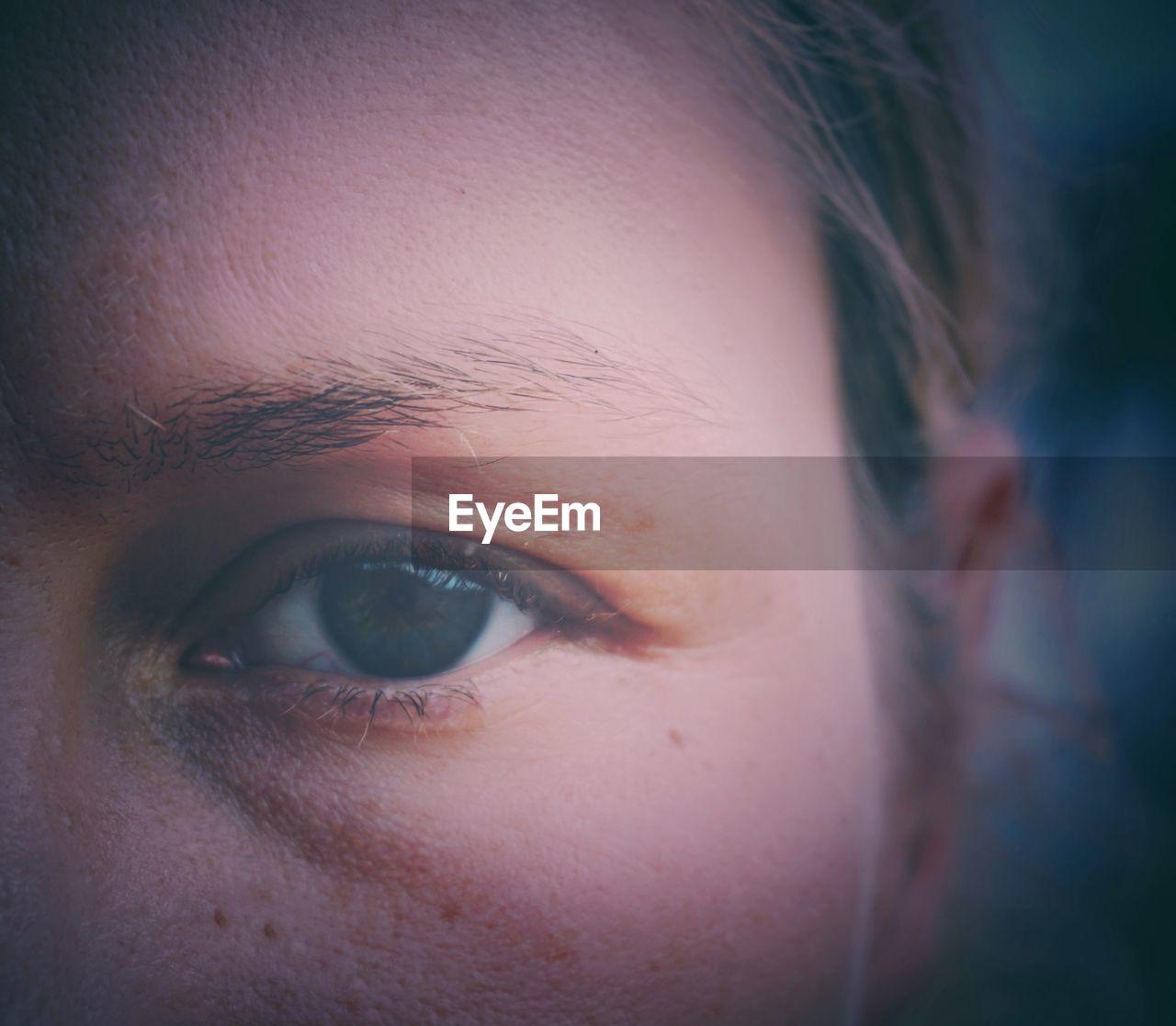 human eye, one person, human body part, real people, close-up, sensory perception, looking at camera, human skin, portrait, eyebrow, eyelash, eyeball, human face, eyesight, women, day, outdoors, young adult, adult, people