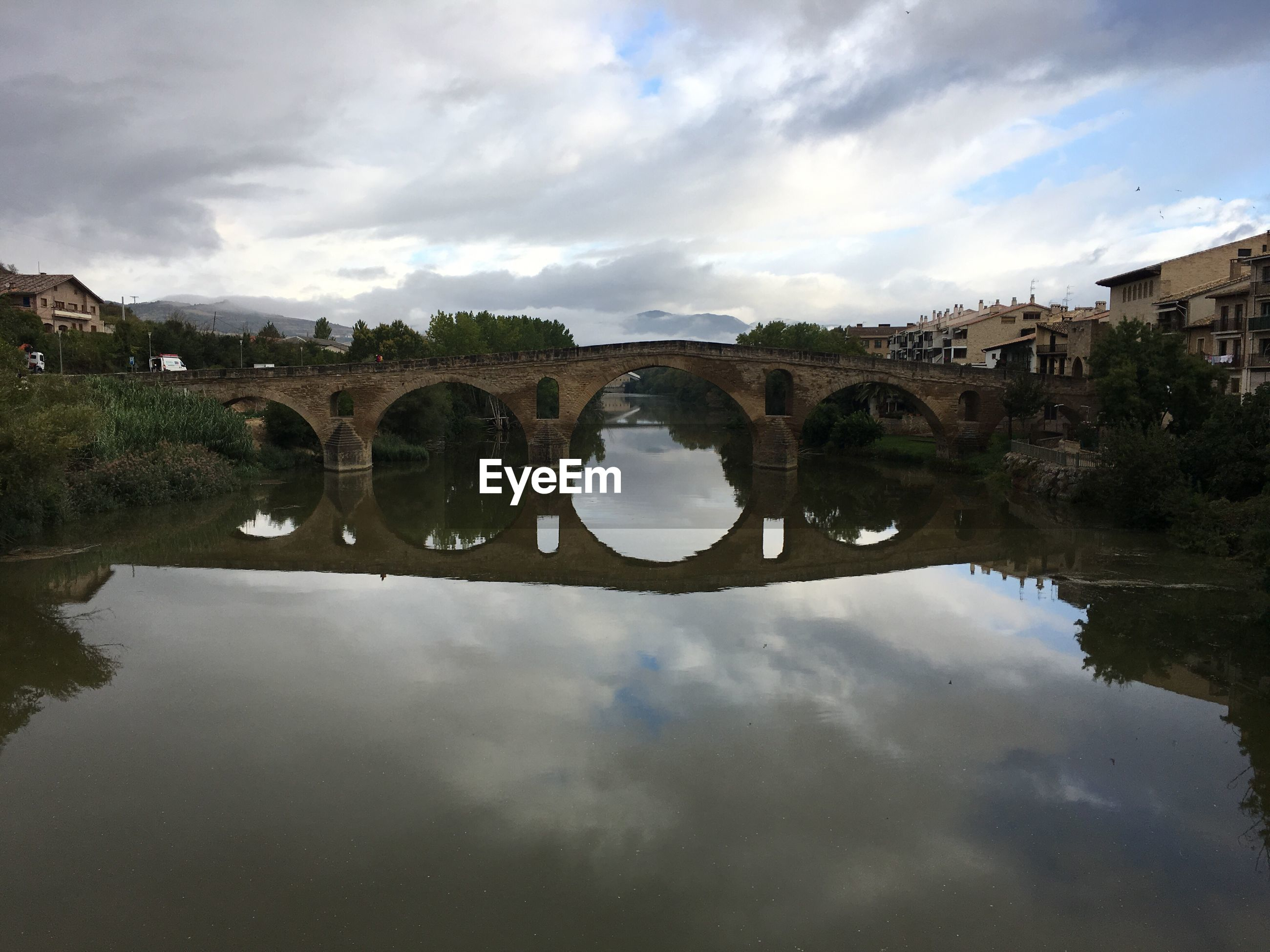 REFLECTION OF BRIDGE ON WATER