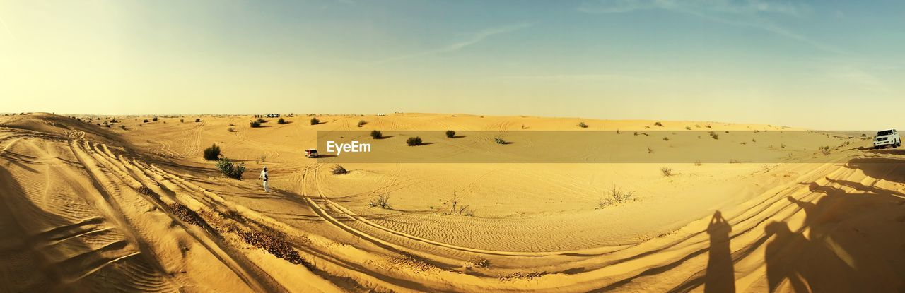 PANORAMIC VIEW OF SAND DUNE AGAINST SKY