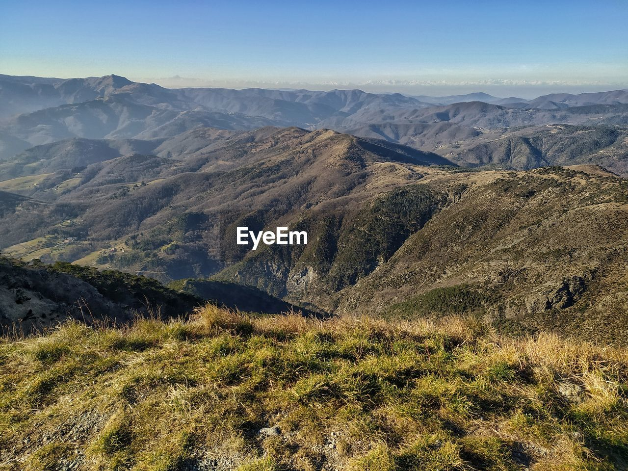 Ligurian appennino to the alps. at horizon the alpine snowcapped arch from monviso to rosa.