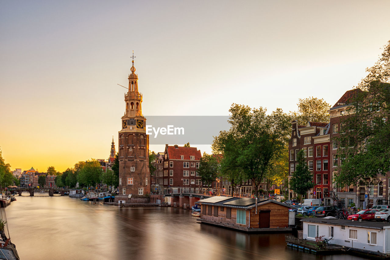 building exterior, architecture, built structure, water, sky, building, nautical vessel, transportation, city, mode of transportation, waterfront, nature, river, religion, tower, travel destinations, belief, place of worship, travel, no people, outdoors, passenger craft