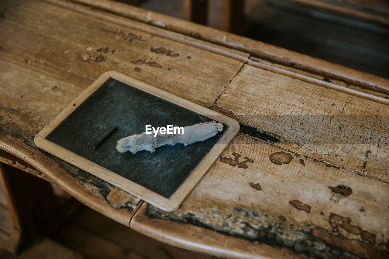 High angle view of slate on table