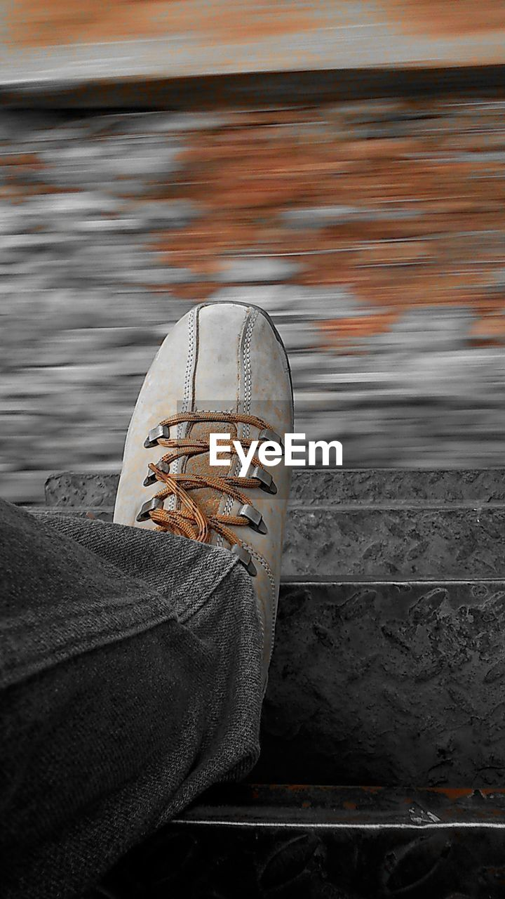 low section, shoe, personal perspective, human leg, one person, human body part, water, day, close-up, real people, outdoors, one man only, people