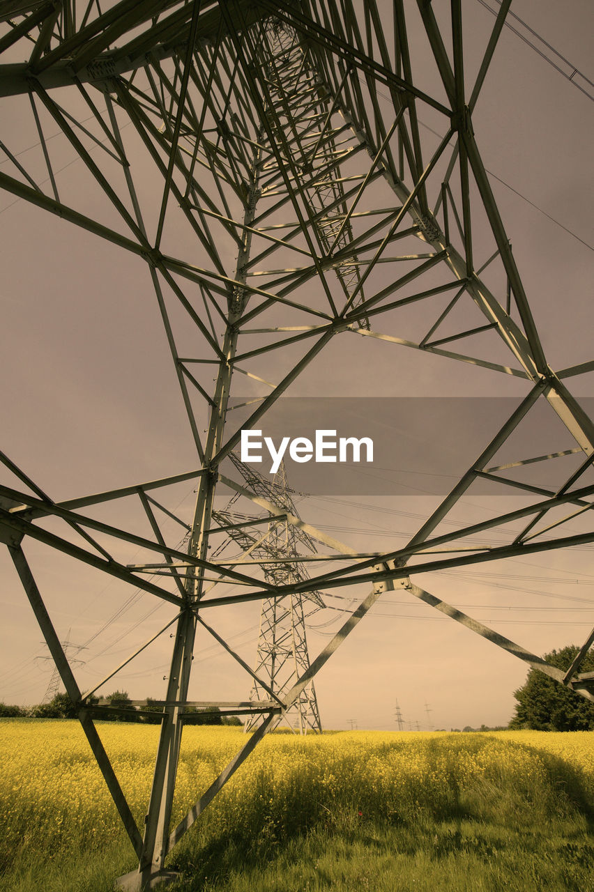 fuel and power generation, field, land, sky, plant, environment, no people, electricity pylon, electricity, nature, grass, built structure, power supply, technology, architecture, connection, landscape, metal, power line, outdoors, steel