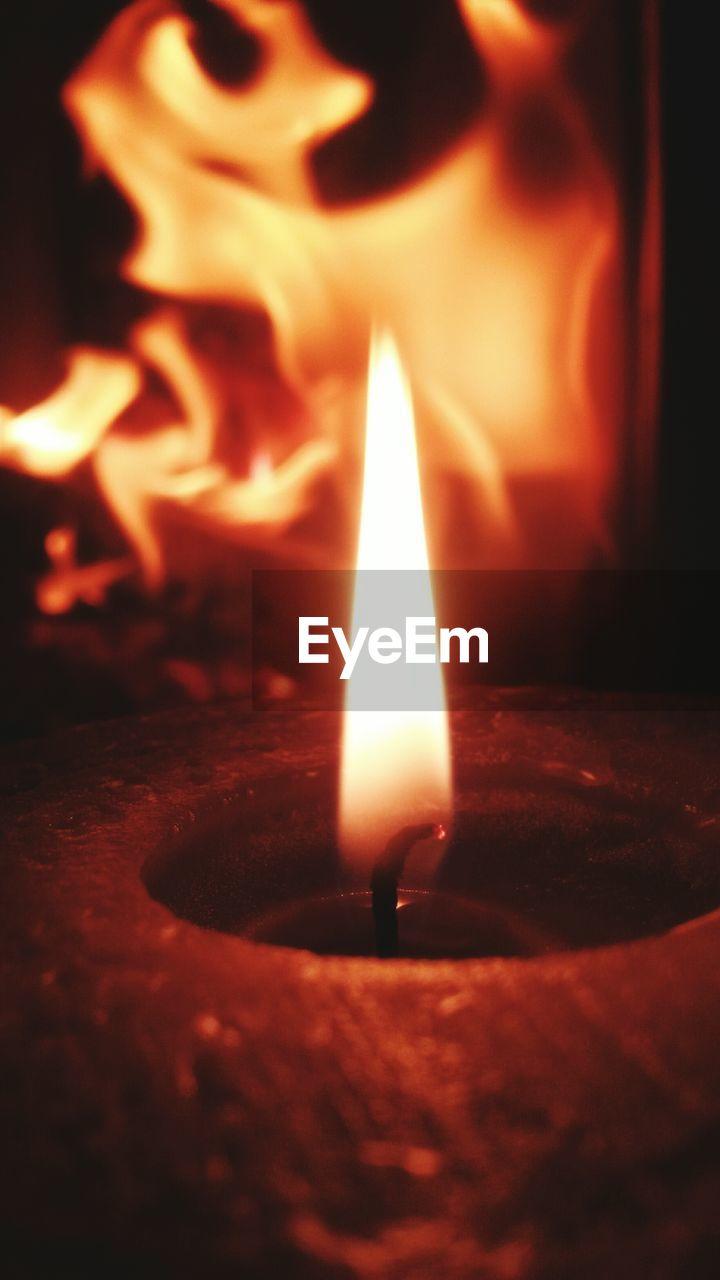 flame, burning, heat - temperature, night, glowing, candle, close-up, no people, indoors, illuminated, diya - oil lamp