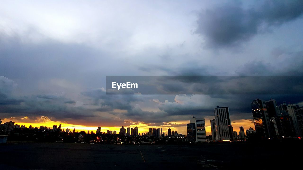 architecture, building exterior, sky, cloud - sky, built structure, skyscraper, travel destinations, sunset, no people, cityscape, city, outdoors, nature, beauty in nature, storm cloud, scenics, modern, urban skyline, illuminated, day