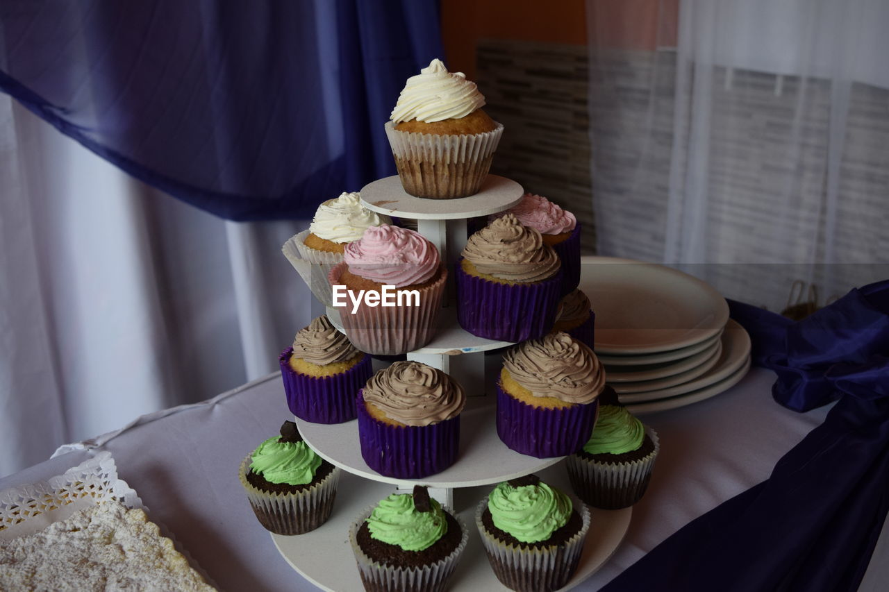 sweet food, sweet, dessert, indulgence, cake, temptation, food and drink, unhealthy eating, indoors, baked, food, freshness, still life, variation, choice, no people, ready-to-eat, cupcake, table, large group of objects, tray, macaroon, cupcake holder, snack