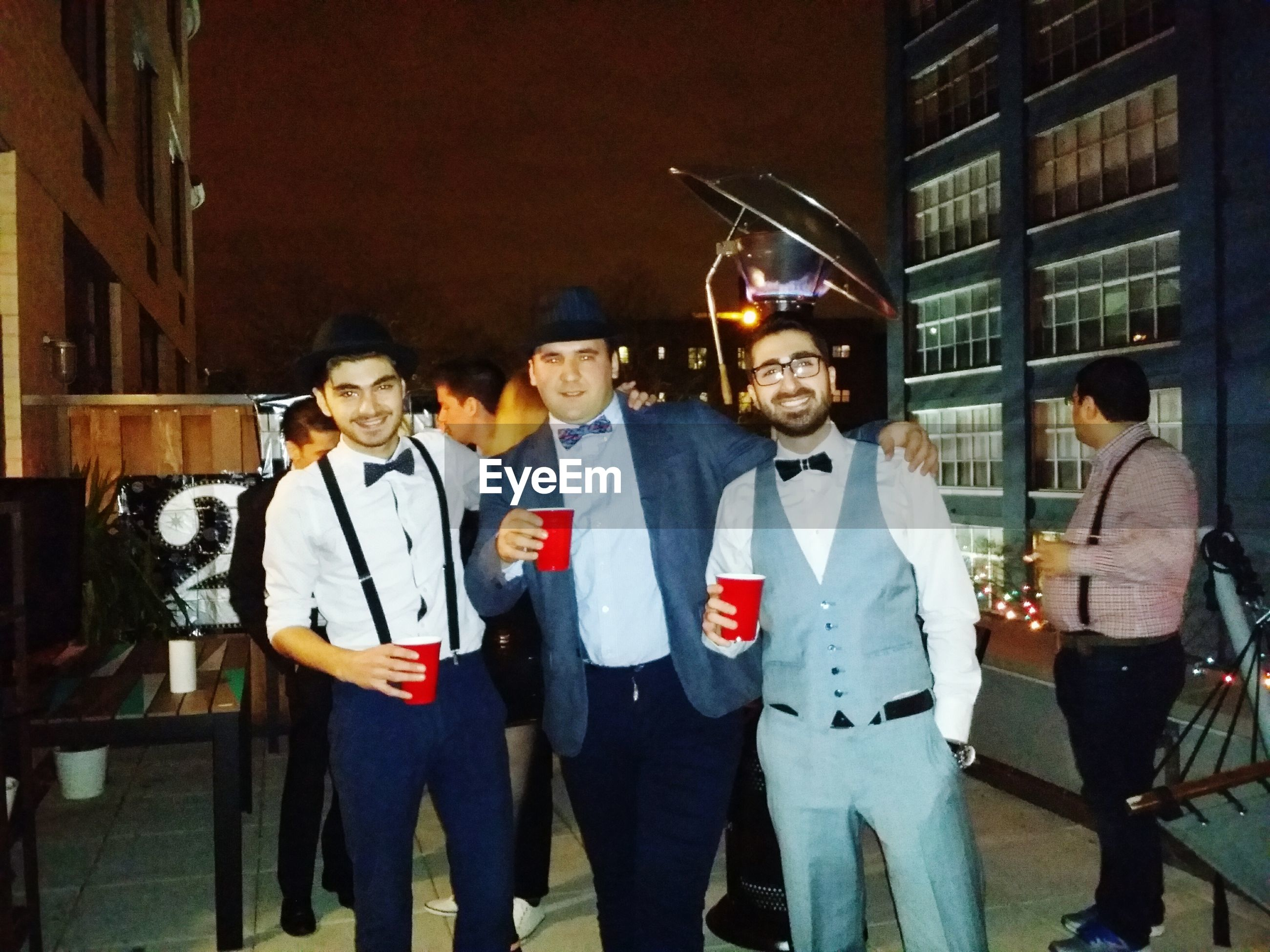 lifestyles, person, portrait, leisure activity, casual clothing, looking at camera, young adult, happiness, front view, togetherness, smiling, young men, three quarter length, standing, bonding, fun, love