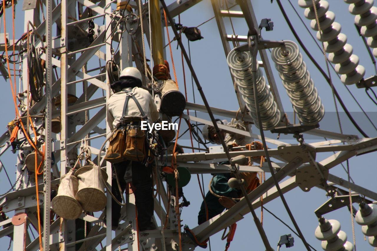 Maintenance Engineers Repairing Electricity Pylon