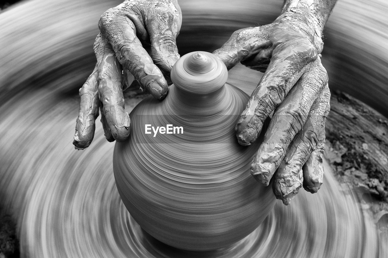 spinning, human hand, hand, motion, pottery, art and craft, clay, occupation, craft, working, skill, molding a shape, creativity, mud, blurred motion, human body part, making, dirt, craftsperson, expertise, finger