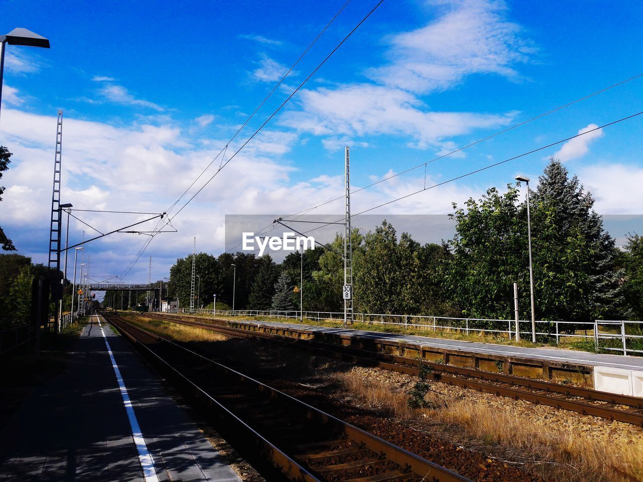 rail transportation, track, railroad track, transportation, cloud - sky, sky, nature, cable, plant, tree, public transportation, mode of transportation, electricity, no people, power line, day, technology, connection, train, electricity pylon, power supply, outdoors
