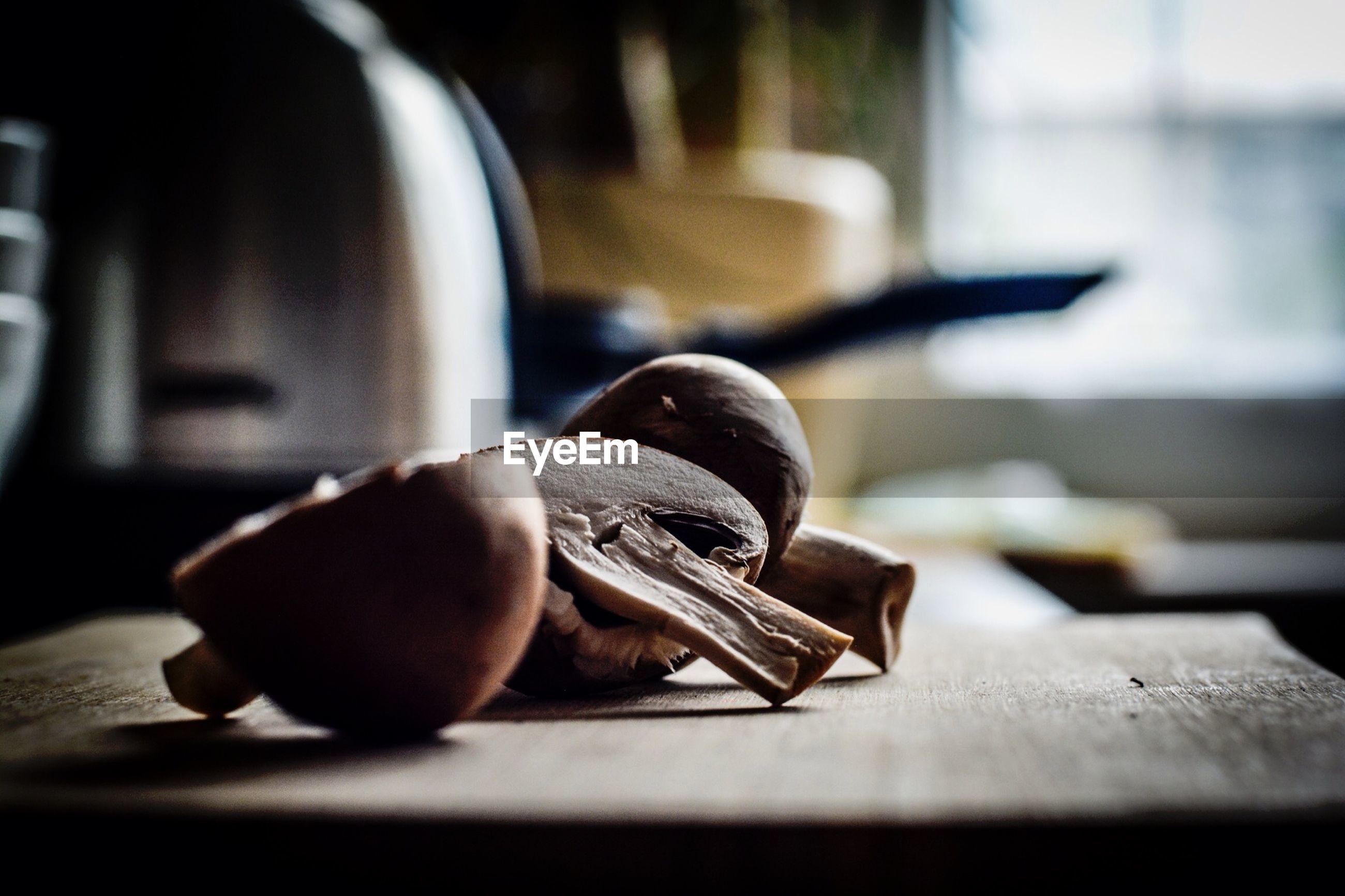 Close-up of halved mushroom on table