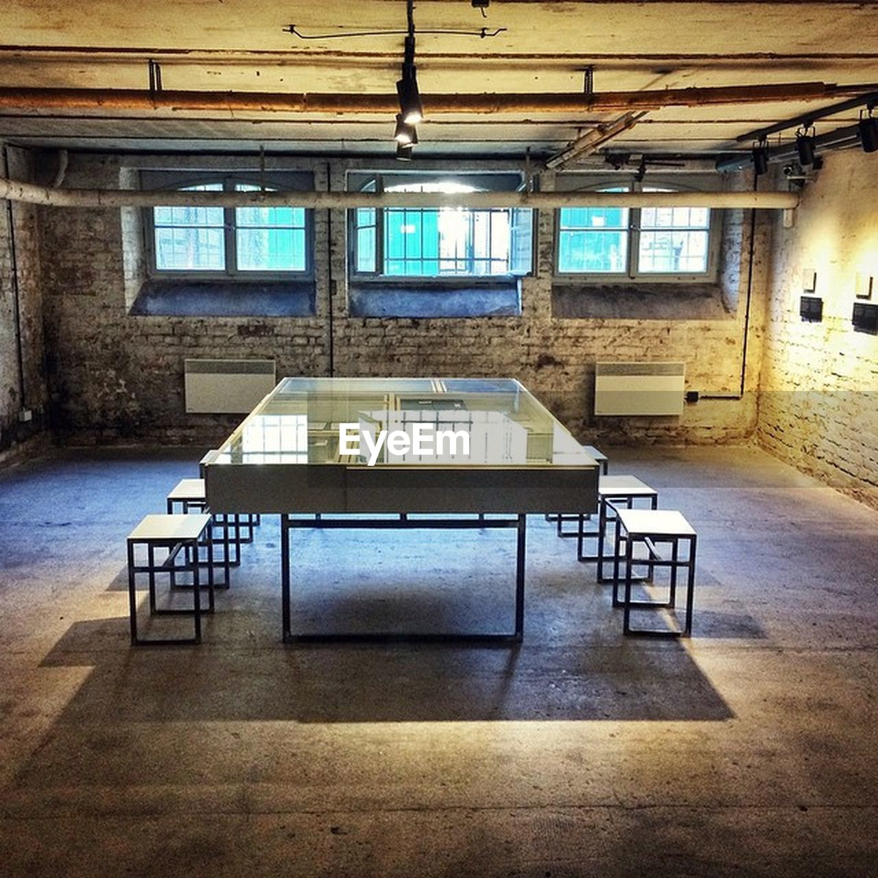 indoors, seat, table, absence, window, architecture, no people, empty, built structure, chair, day, building, furniture, wood - material, flooring, education, bench, old, wall - building feature, ceiling, setting