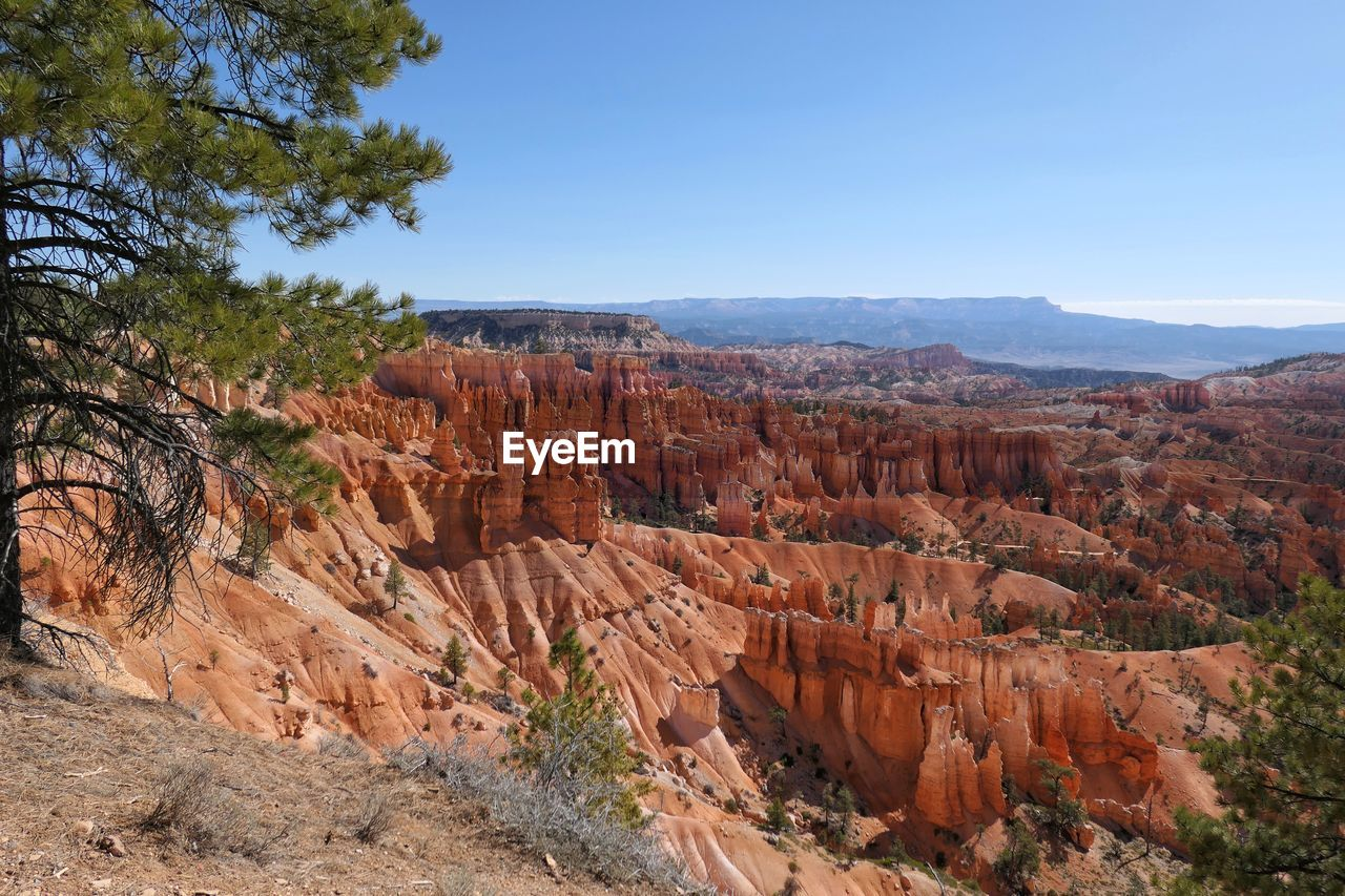 rock, scenics - nature, rock formation, rock - object, tranquil scene, solid, non-urban scene, tranquility, beauty in nature, travel destinations, physical geography, travel, sky, geology, nature, environment, canyon, landscape, mountain, remote, no people, eroded, outdoors, climate, arid climate, formation