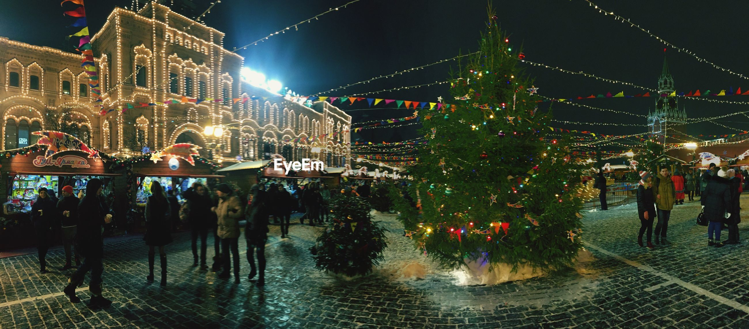 illuminated, night, celebration, hanging, multi colored, christmas lights, christmas decoration, christmas, outdoors, holiday - event, large group of people, tree, sky, city, people, christmas market, architecture