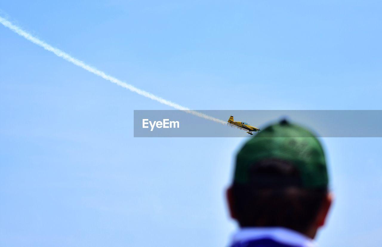 Rear View Of Man Looking At Airshow