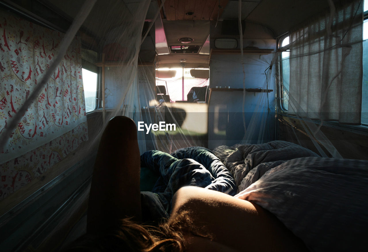 Young Woman Lying In Motor Home