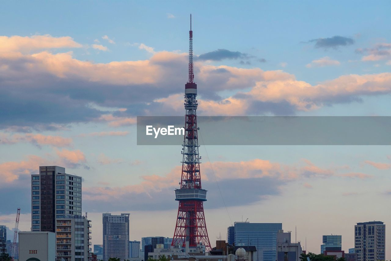architecture, built structure, sky, building exterior, tower, tall - high, cloud - sky, city, building, nature, travel destinations, travel, no people, sunset, outdoors, low angle view, office building exterior, tourism, skyscraper, spire, global communications