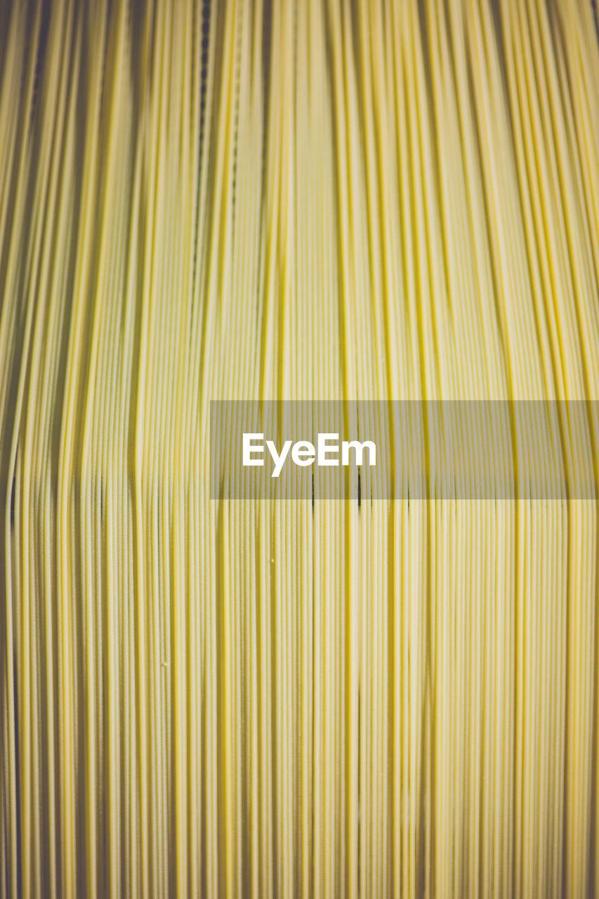 Full Frame Shot Of Spaghetti Drying In Factory