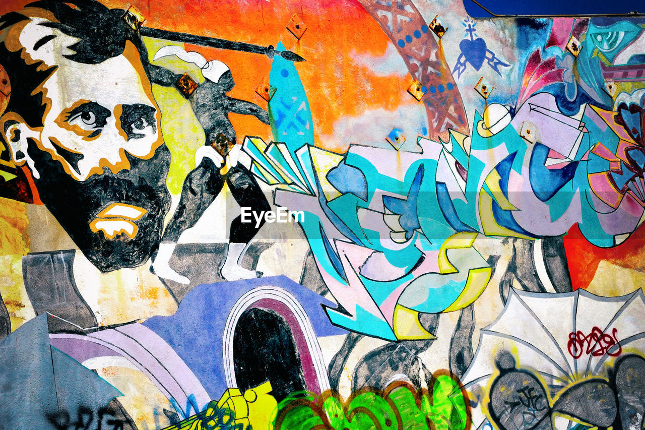 graffiti, art and craft, street art, multi colored, creativity, artist, painted image, architecture, built structure, building exterior, outdoors, youth culture, day, close-up, city, ghetto, people