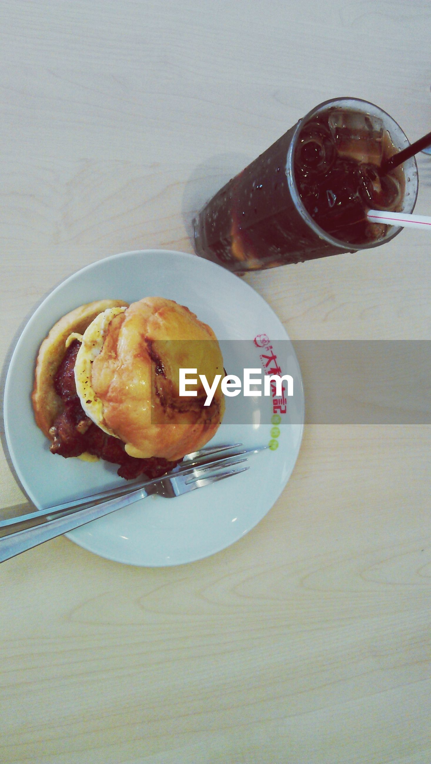 food and drink, indoors, food, freshness, table, still life, drink, ready-to-eat, plate, refreshment, spoon, fork, indulgence, serving size, sweet food, coffee cup, high angle view, dessert, coffee - drink, breakfast