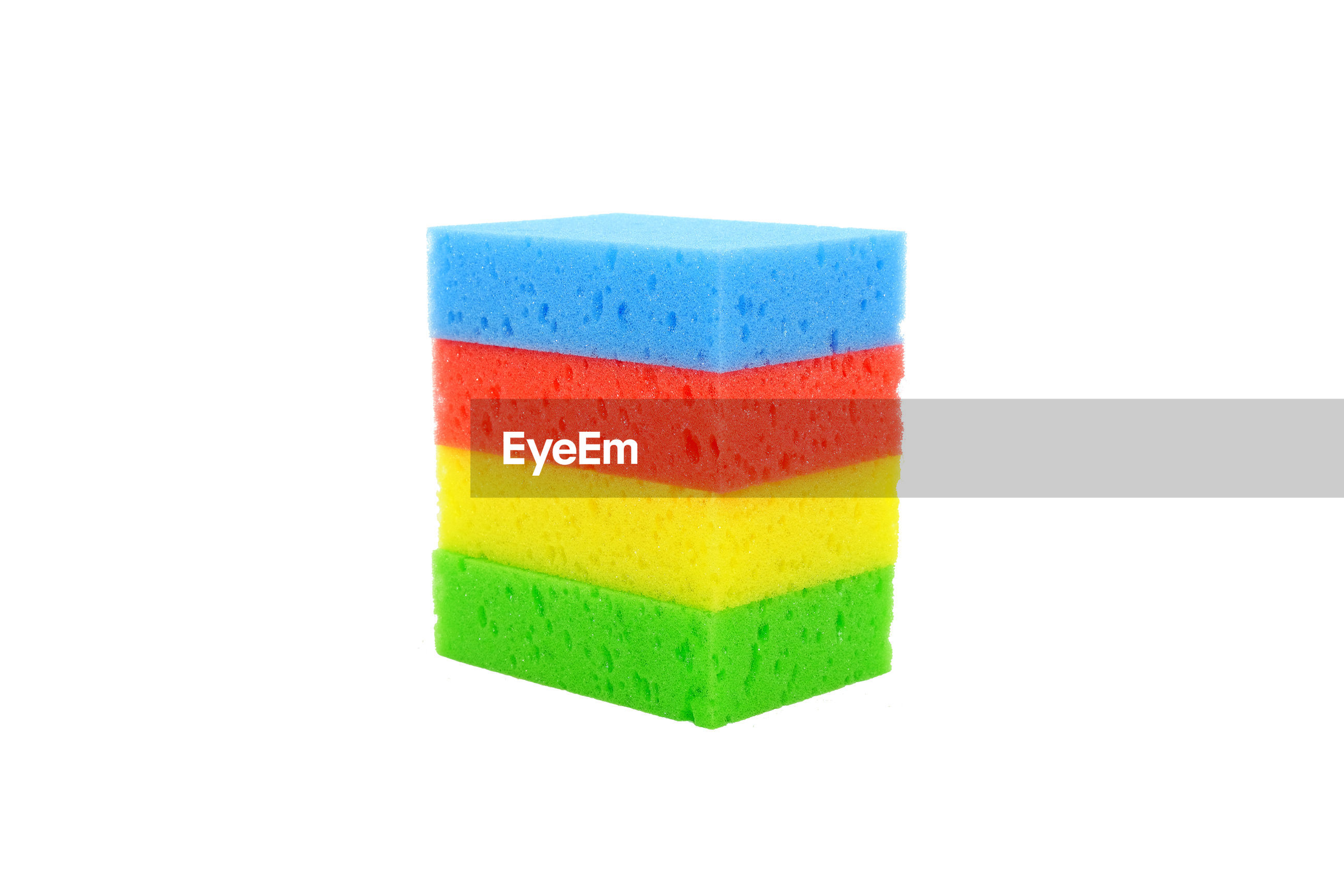 Close-up of multi colored cleaning sponges over white background