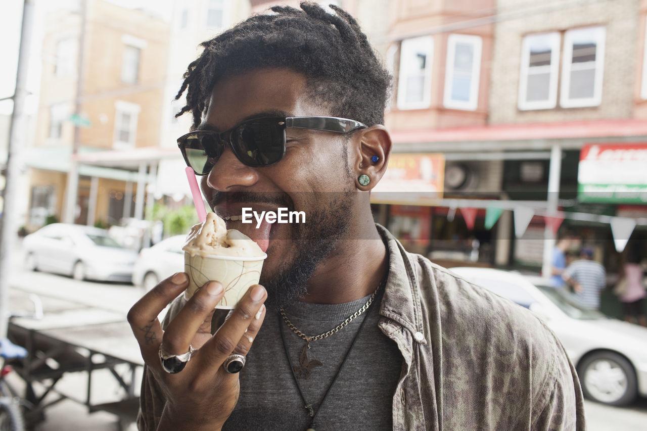 A young man eating frozen yogurt