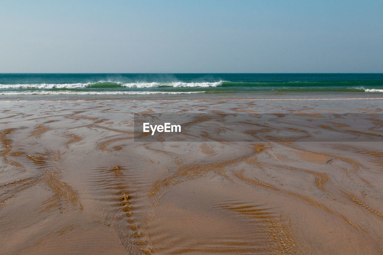 sea, water, land, beach, sky, horizon over water, horizon, scenics - nature, sand, beauty in nature, tranquility, tranquil scene, nature, clear sky, wave, no people, motion, day, idyllic, outdoors