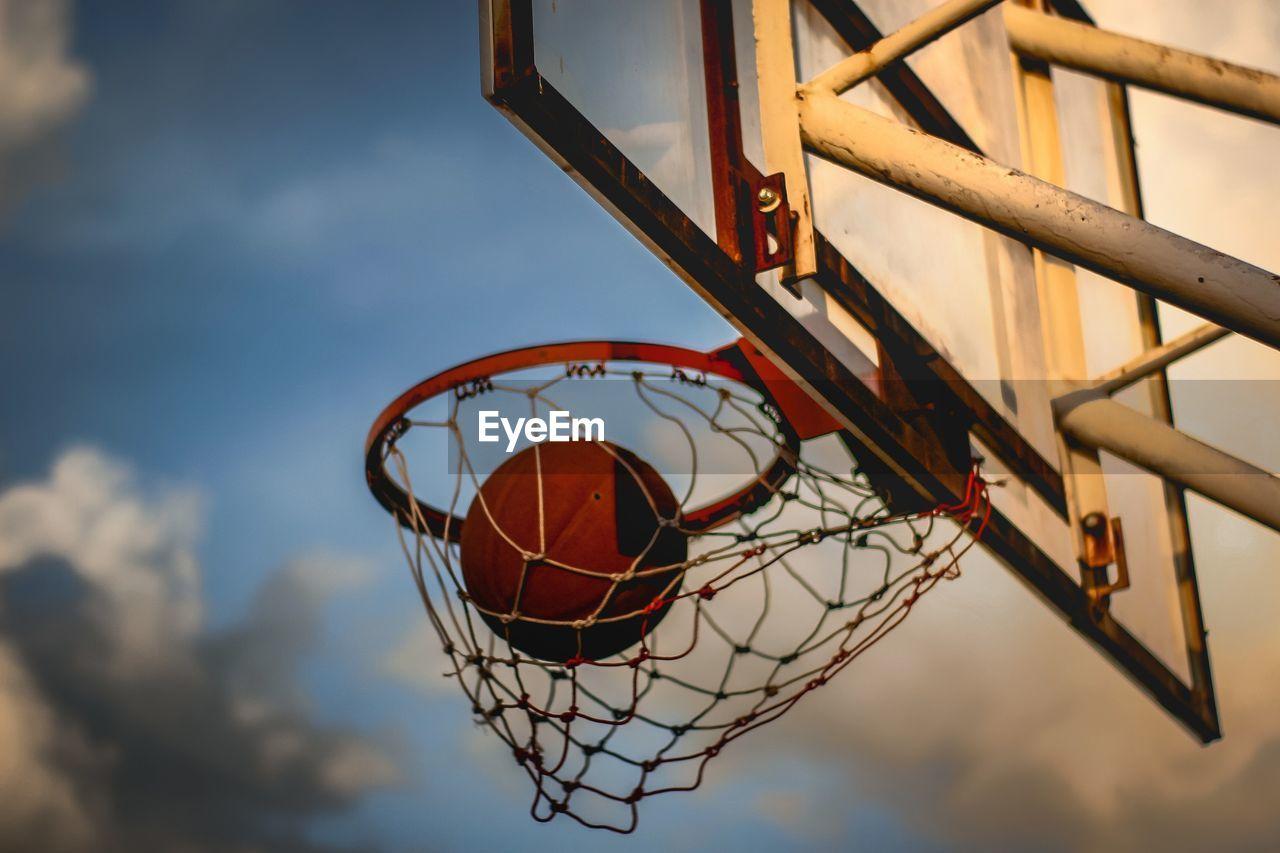 CLOSE-UP OF BASKETBALL HOOP AGAINST SKY