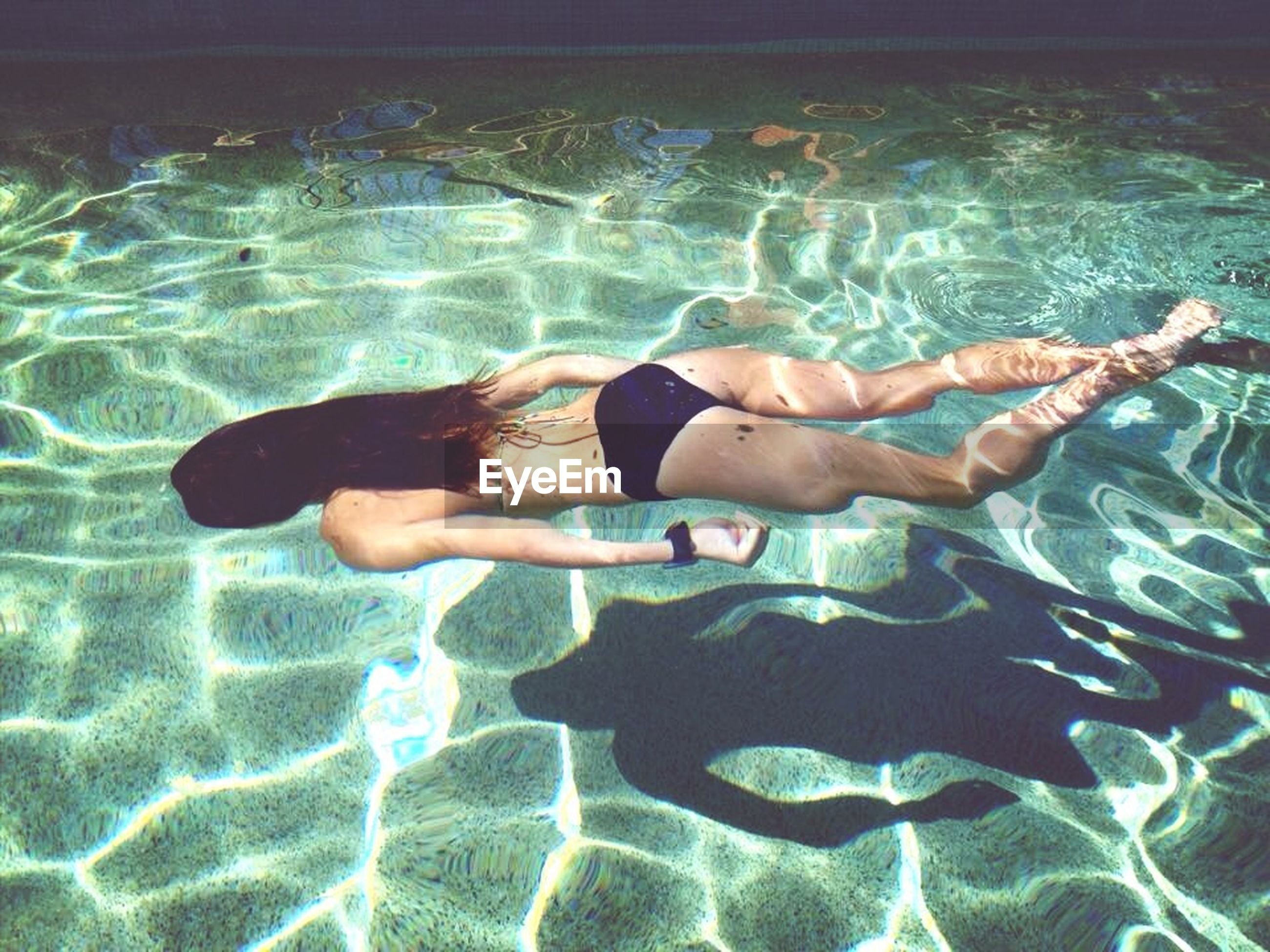 lifestyles, leisure activity, water, swimming pool, barefoot, enjoyment, shirtless, vacations, person, bikini, young adult, full length, sea, carefree, swimming, fun, relaxation, young women