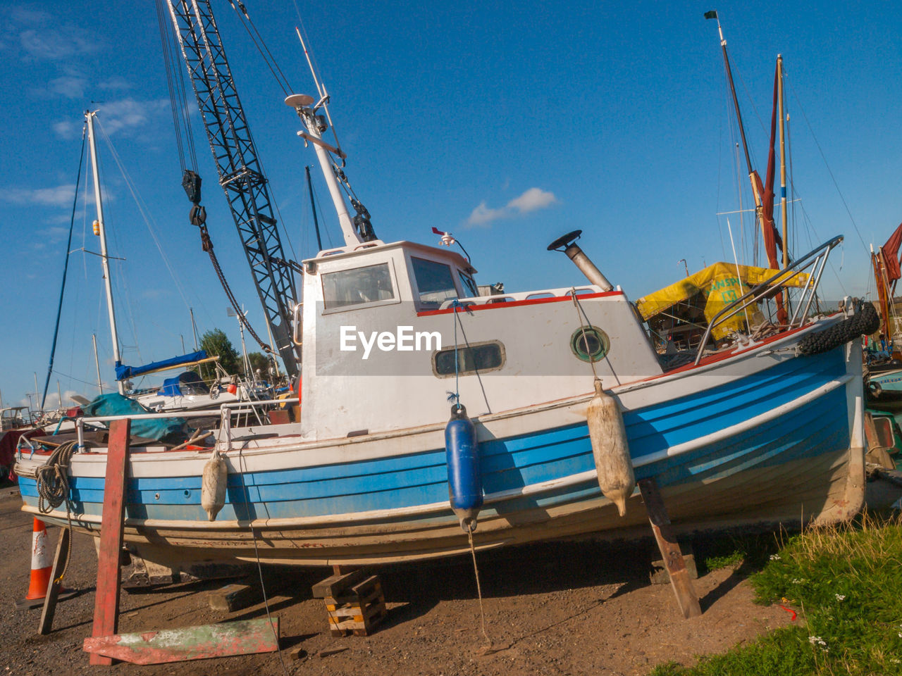 mode of transportation, nautical vessel, transportation, sky, moored, water, nature, day, no people, blue, sunlight, clear sky, outdoors, beach, sailboat, mast, travel, land, sea, fishing boat, fishing industry, port