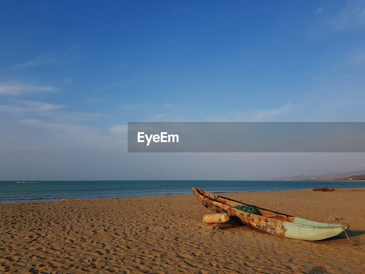 sea, sky, water, beach, land, horizon over water, horizon, beauty in nature, sand, nautical vessel, scenics - nature, transportation, tranquility, tranquil scene, mode of transportation, nature, moored, day, idyllic, no people, outdoors, rowboat